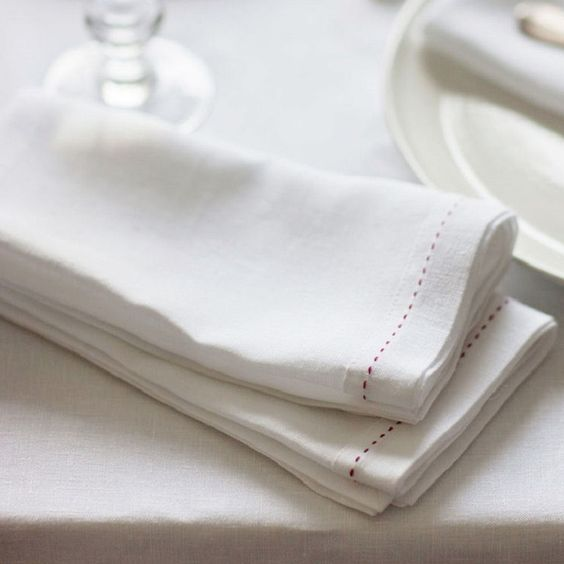 The Linen Works Raspberry Stitched White Set of 4 Napkins - £50.00